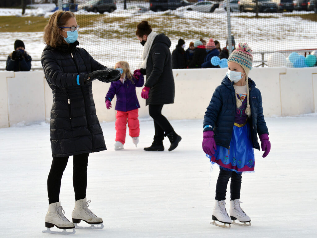 Ice skaters on rink